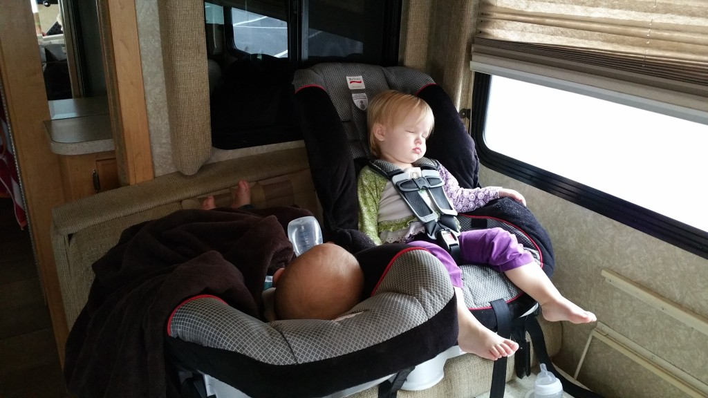 On the road again... Benji & Lily napping as we stop at Safeway to get more supplies (and coffee!).