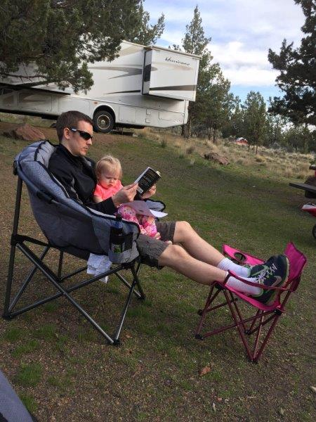 Lily and Daddy relaxing and reading.